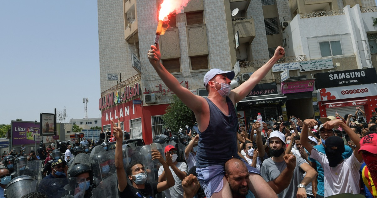 Tunisians protest as COVID surges, economy suffers
