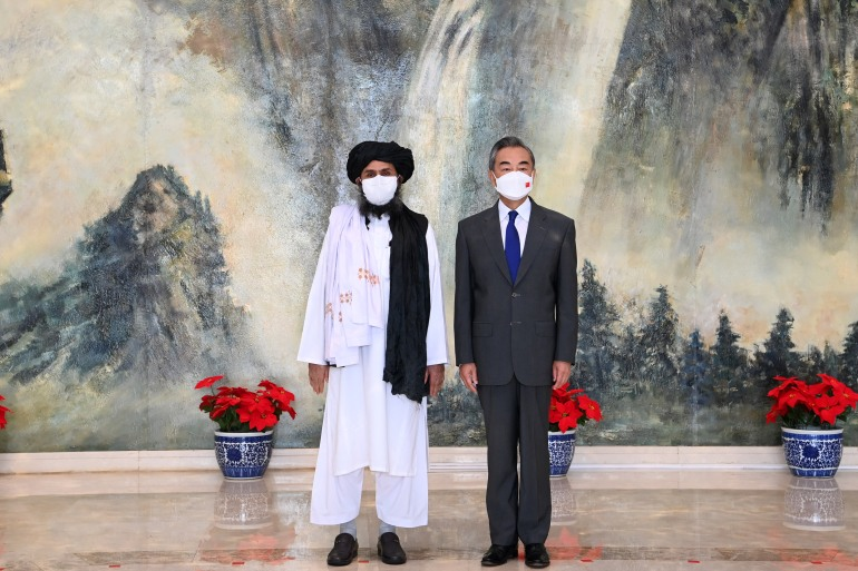 Chinese State Councilor and Foreign Minister Wang Yi (R) meeting with Mullah Abdul Ghani Baradar, political chief of Afghanistan's Taliban, in Tianjin [Li Ran / Xinhua/AFP]