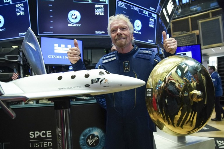 A successful flight by Branson on board Virgin's VSS Unity spaceplane would mean that he would travel beyond Earth's atmosphere ahead of Bezos, the founder of rival space tourism venture Blue Origin [File: Drew Angerer /Getty Images via AFP]