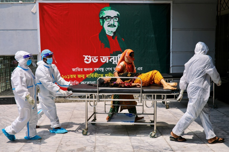 A patient infected with the coronavirus arrives for treatment at the Dhaka North City Corporation COVID-19 temporary hospital, in Dhaka [Mohammad Ponir Hossain/Reuters]