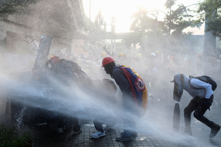Demonstrators clash with police during anti-government protests in Medellin on June 28, 2021 [File: Santiago Mesa/Reuters]