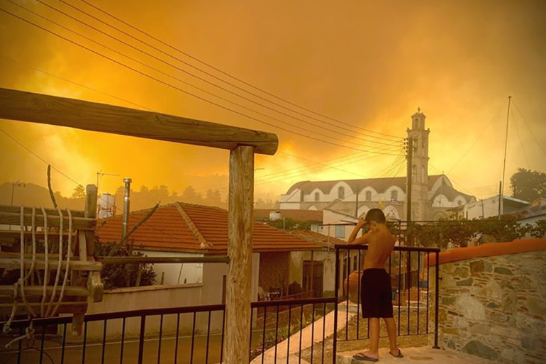Smoke from a forest fire is seen in Ora village, Larnaca, Cyprus [Andrea Anastasiou via Reuters]