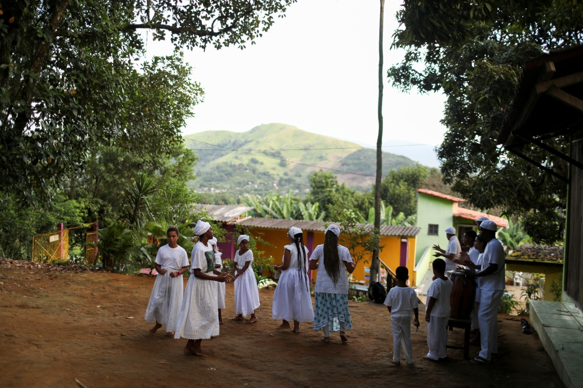 Twice a week, Luther visits a local 'terreiro' to practise Umbanda, a religion with origins in West African spiritual traditions. 'It connects me with my ancestry,' he said. [Pilar Olivares/Reuters]