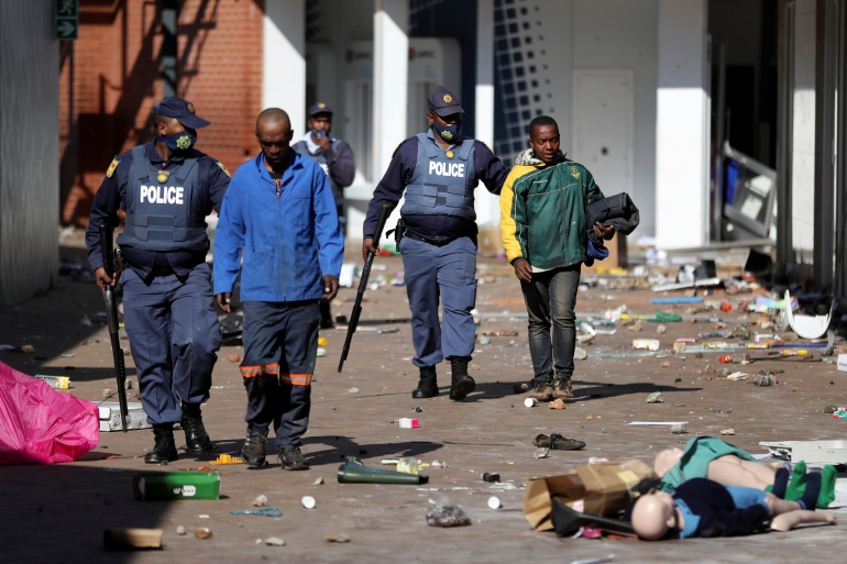 Police said six people have been killed and more than 200 arrested in protests and looting since last week [Siphiwe Sibeko/Reuters]
