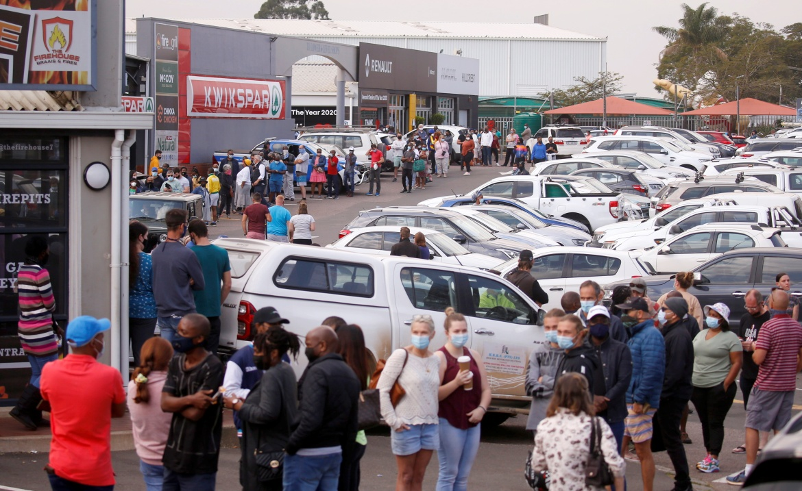 People queue to buy food at a supermarket, with most stores staying closed in Hillcrest, South Africa. [Rogan Ward/Reuters]