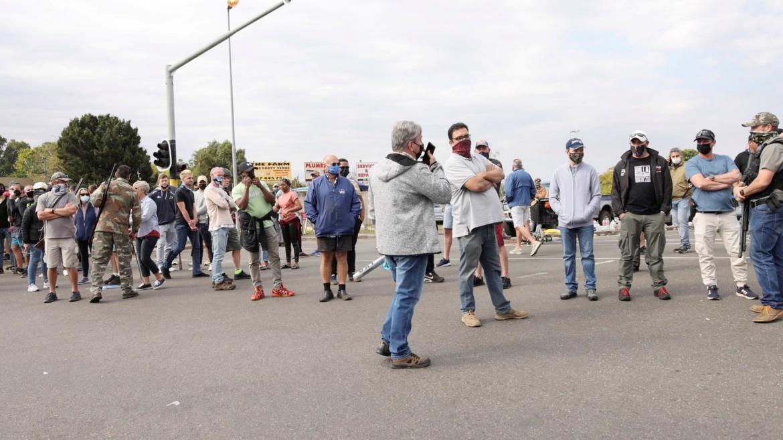 Residents block off streets as looters ransack Durban shops. [Courtesy of Kierran Allen via Reuters]