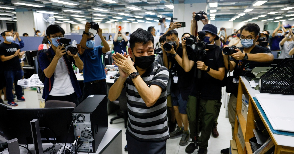 Hong Kong police arrest former Apple Daily top editor