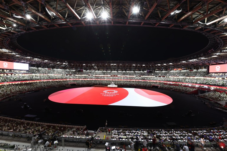 The Tokyo 2020 Olympics officially began with the opening ceremony on Friday [Marko Djurica/Reuters]