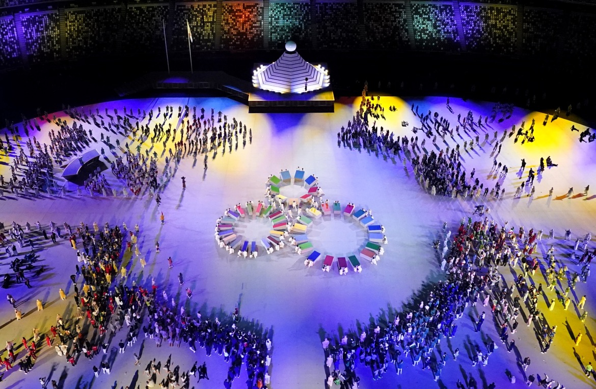 The ceremony wove together references to both Japan's traditional crafts and its globally adored video games, with athletes entering to theme music from famed titles. [Fabrizio Bensch/Reuters]