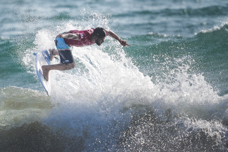 Italo Ferreira of Brazil in the men's round 1 surfing competition during Tokyo 2020 at Tsurigasaki Surfing Beach [Andrew Nelles/ USA Today Network via Reuters]