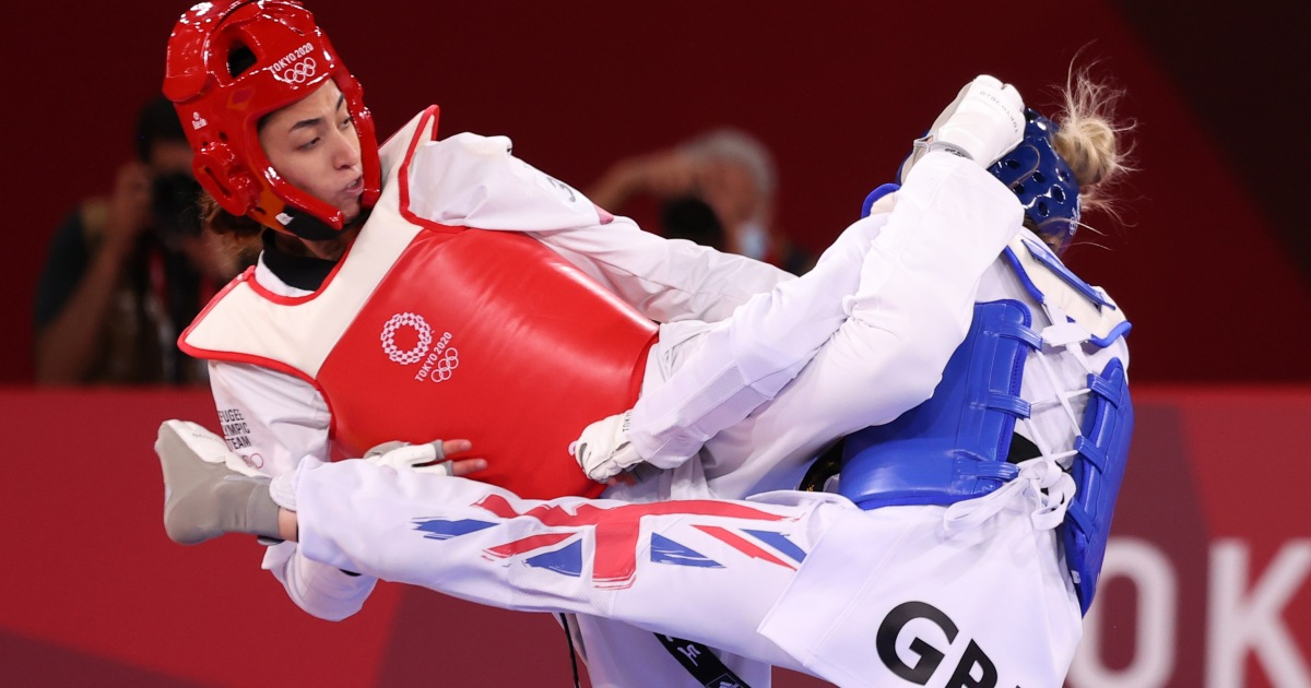 Iranian refugee shocks Olympic gold medalist Jones at Tokyo 2020 - aljazeera