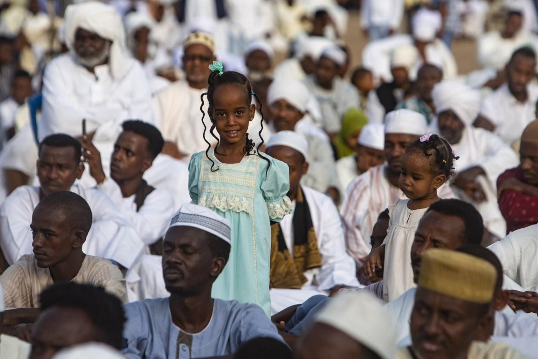 Worshippers perform Eid al-Adha prayers at al-Farah Square in Khartoum, Sudan. [Mahmoud Hjaj/Anadolu]