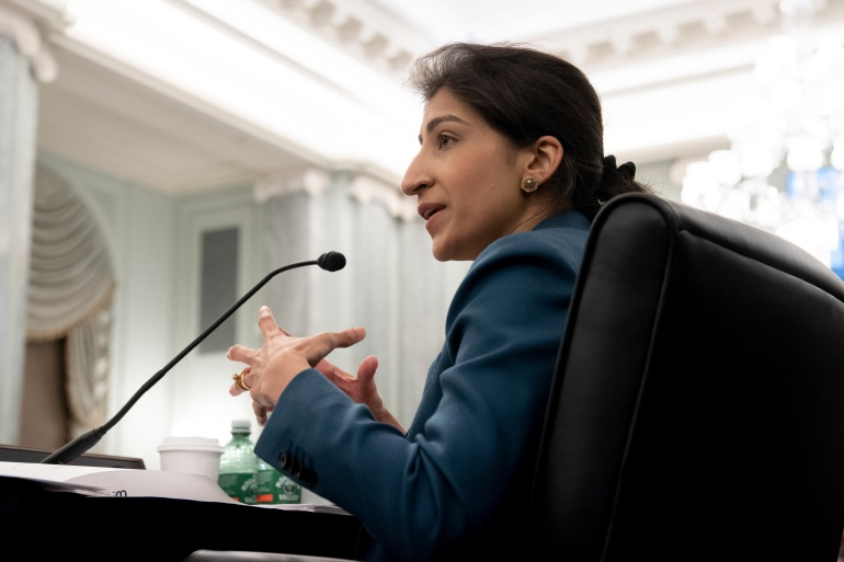 Since Lina Khan was named Federal Trade Commission chair by United States President Joe Biden in mid-June, two tech giants — Amazon and Facebook — have filed petitions to have her recused from decisions concerning them [File: Saul Loeb/Pool via AP]