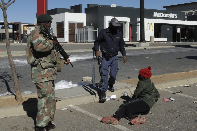Some 200 malls and shopping centres countrywide have been affected by the violence and forced to close [Themba Hadebe/AP Photo]