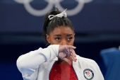 Simone Biles, 24, is widely considered to be the best gymnast of all time [Ashley Landis/AP Photo]