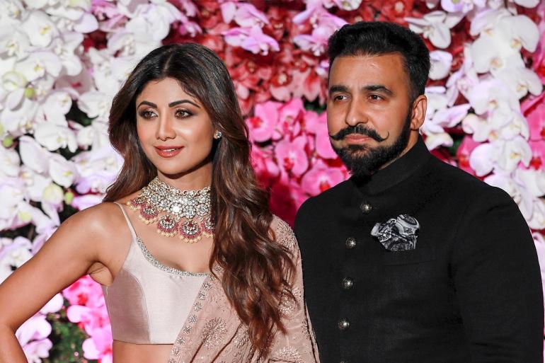 Kundra, right, and Shetty pose as they arrive to attend the wedding reception of Akash Ambani, son of Indian billionaire Mukesh Ambani, in Mumbai [File: Divyakant Solanki/EPA]