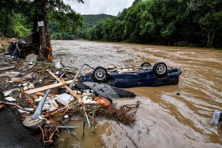 Large parts of western Germany were hit by heavy, continuous rain on Wednesday night, which continued on Thursday, resulting in local flash floods that destroyed buildings and swept away cars [Sascha Steinbach/EPA]