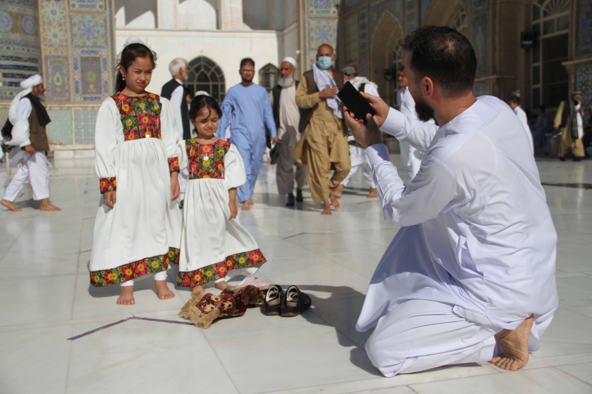 Afghans arrive at a mosque to offer Eid al-Adha prayers in Herat, Afghanistan. [Jalil Rezayee/EPA]