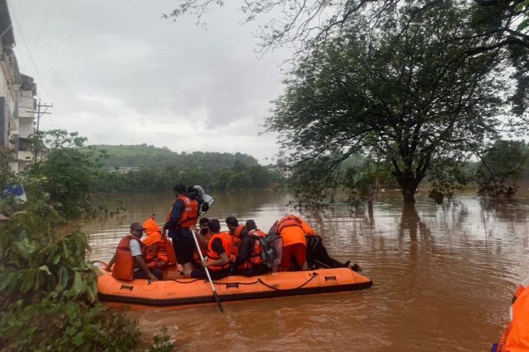 Rescuers were scouring the mud and debris for at least 99 others still missing [EPA]