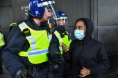 A protester speaks with a police officer during a Black Lives Matter protest in London, UK, June 13, 2020. (Reuters)