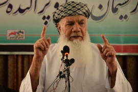 Afghan commander and former mujahideen leader Ismail Khan addresses a gathering at his house in Herat [AFP]