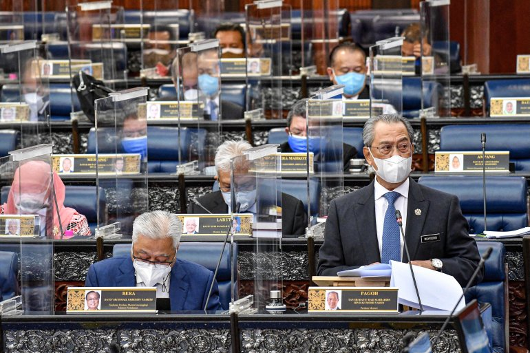 Malaysia's Prime Minister Muhyiddin Yassin remained defiant on Wednesday, saying he had the necessary support in parliament to lead the country [File: Nazri Rapaai/Malaysia's Department of Information via AFP]