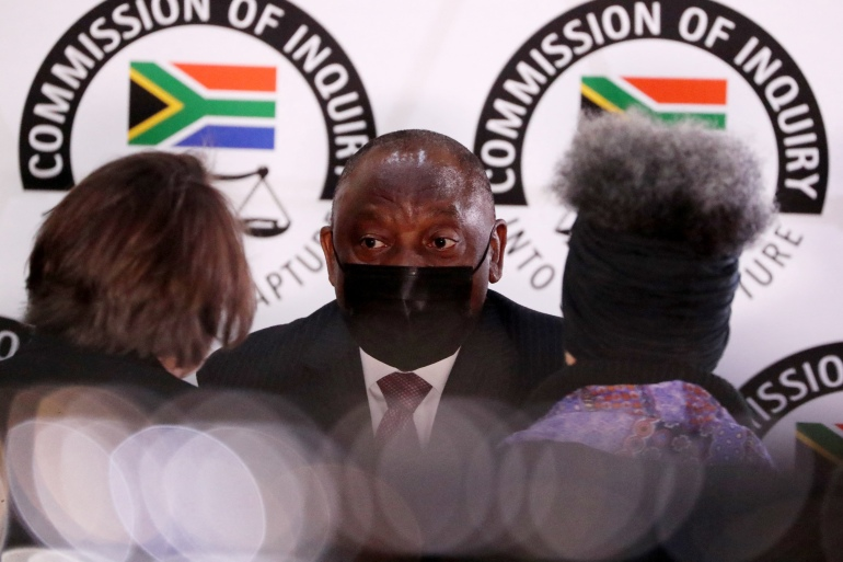 Ramaphosa has been criticised for being slow to act on corruption scandals [Sumaya Hisham/AFP]