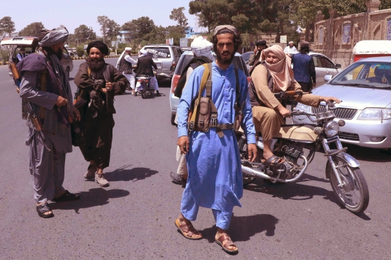 Taliban fighters patrol the streets in Herat on August 14, 2021. Herat is one of the 22 provincial capitals to fall to the group since August 6 [Stringer/ AFP]