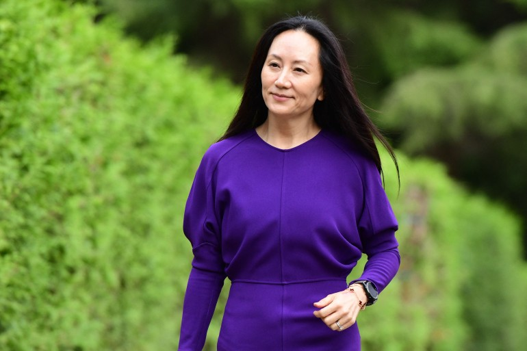 Huawei Chief Financial Officer Meng Wanzhou leaves her Vancouver home to attend her last extradition hearing in the British Columbia Supreme Court [Don MacKinnon /AFP]