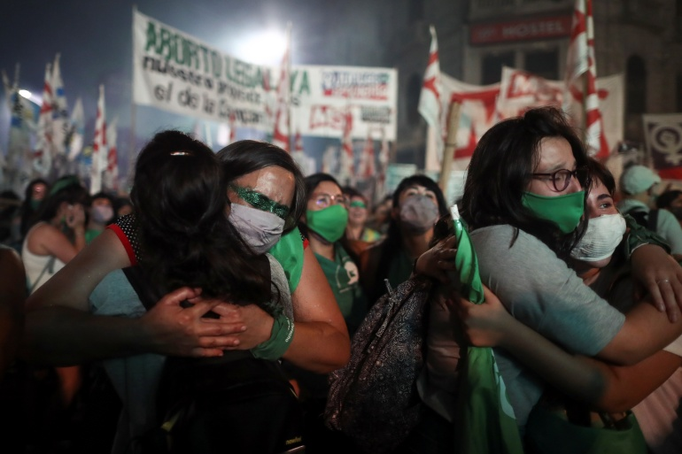 Demonstrators in favour of legalising abortion react after the Senate passed an abortion bill, in Buenos Aires, Argentina on December 30, 2020 [File: Reuters/Agustin Marcarian]