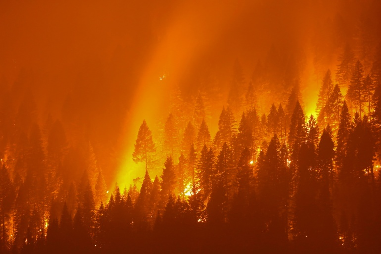 Wildfires burn in the US West for a fourth consecutive summer as Washington, DC strives to adopt new climate policies [David Swanson/Reuters]