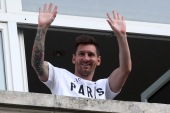 Messi will wear the number 30, his number when he began his pro career at Barcelona [Yves Herman/Reuters]