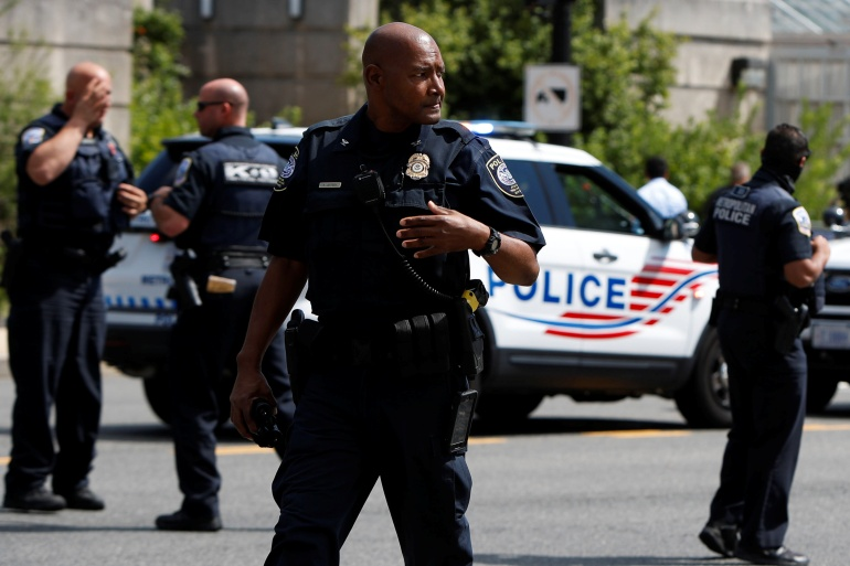 Police officers responding to a bomb threat near the US Capitol in Washington, DC, August 19 [Gabrielle Crockett/Reuters]
