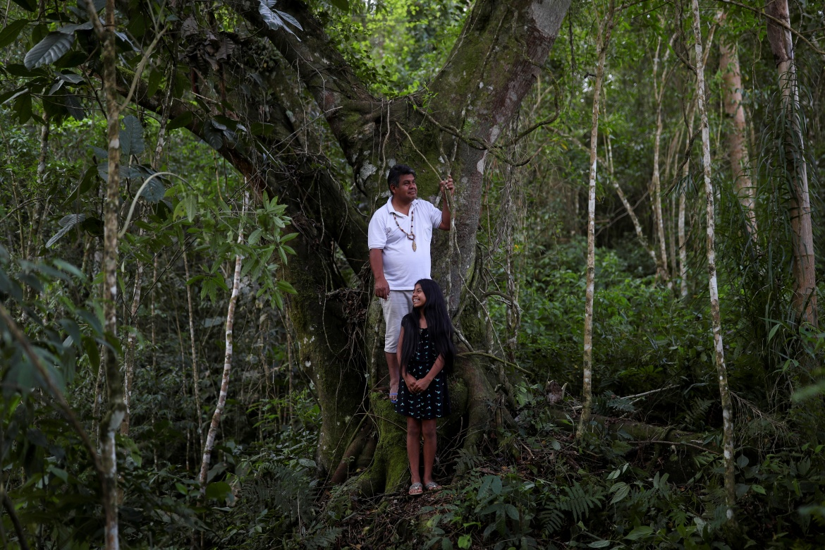 """Lazaro Kamlem, 47, is a descendent of Shaman Kamlem, the Xokleng medicine man who said on his deathbed in 1925 that they would lose their land to """"white men,"""" but would one day gain it back. """"We are here and we will resist to the end. This struggle will not be over,"""" said Kamlem. [Amanda Perobelli/Reuters]"""