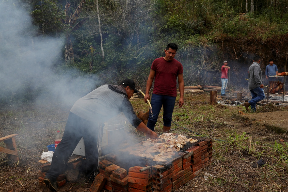 The Xokleng still share their food in communal meals but the beef they roast is bought off the reservation, as they lack enough land to hunt or to raise cattle. [Amanda Perobelli/Reuters]