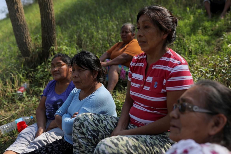 Loreni Ngavem Pripra, 44, sits with Xokleng Indigenous women as they chat after lunch in Xokleng Laklano Indigenous land. [Amanda Perobelli/Reuters]