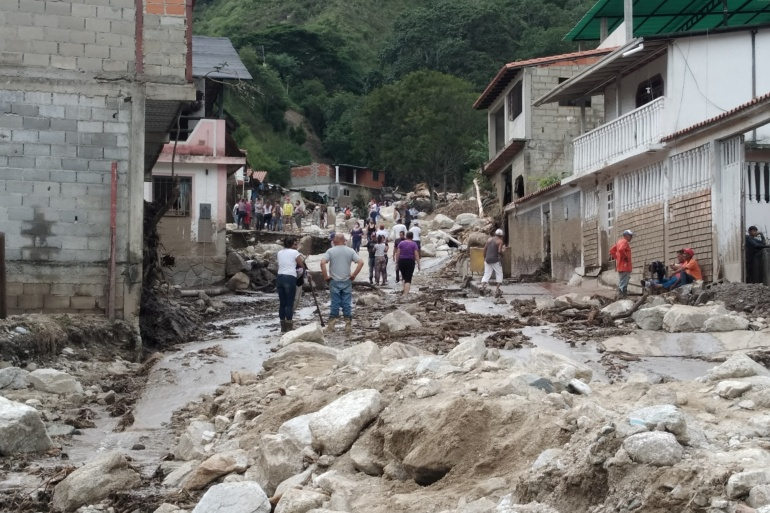Images shared on social media showed cars being swept down streets, buildings and businesses filled with mud and mudslides that left boulders strewn across roads [Courtesy of Comunicacion Continua via Reuters]