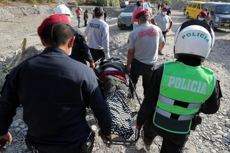 The accident happened on Tuesday on a narrow stretch of the Carretera Central road some 60km (37 miles) east of the capital Lima [Sebastian Castaneda/Reuters]