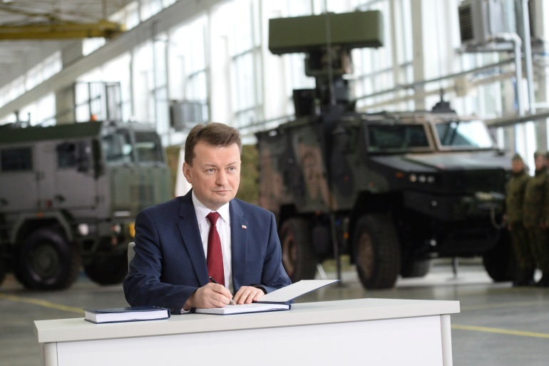 Defence minister Mariusz Blaszczak said more than 900 Polish soldiers are in the operation [File: Alik Keplicz/AP]