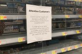 A sign in front of an empty bullet display case informs customers of purchase limits on gun ammunition at a Walmart store in Rochester, New York on May 3, 2021 [File: AP/Ted Shaffrey]