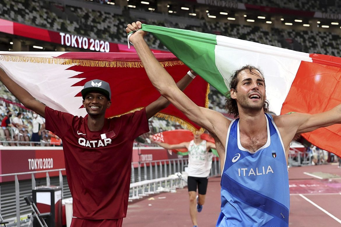 Gold medallists Mutaz Barshim, left, of Qatar and Gianmarco Tamberi of Italy celebrate on the track after the final of the men's high jump. [Christian Petersen/Pool Photo via AP]