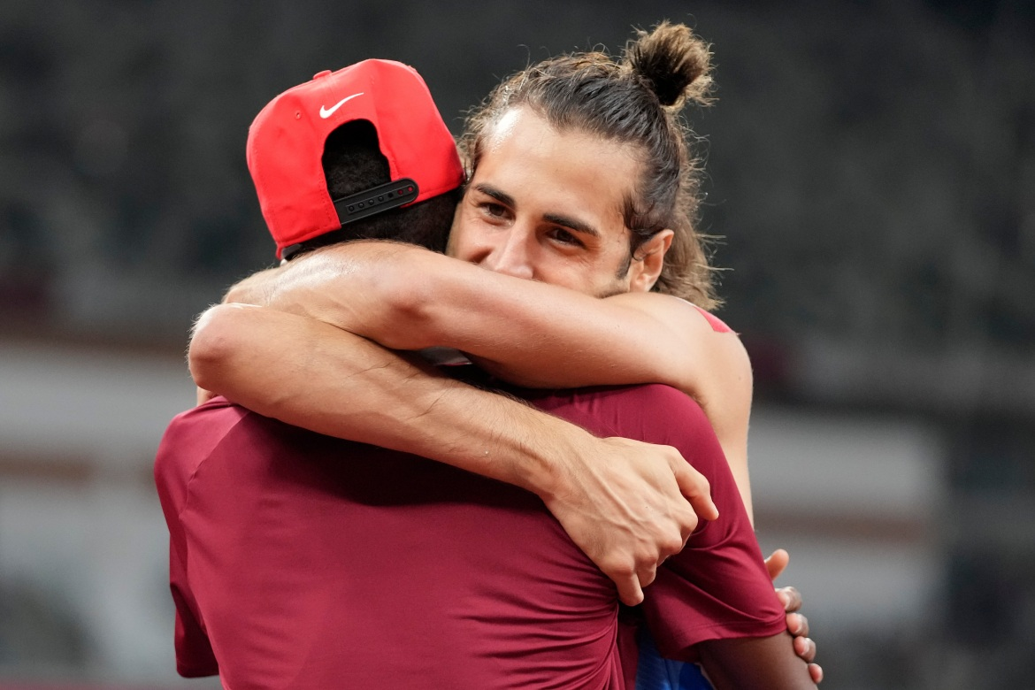 Barshim and Tamberi have been good friends since 2017. Both 30-year-old Barshim and 29-year-old Tamberi did not have a failed attempt until they attempted to clear the 2.39-metre mark. [Matthias Schrader/AP Photo]