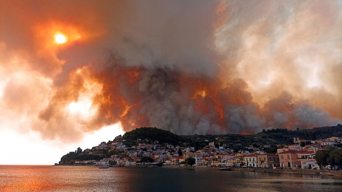 Flames burn on the mountain near Limni village on the island of Evia, about 160km (100 miles) north of Athens. [Michael Pappas/AP Photo]