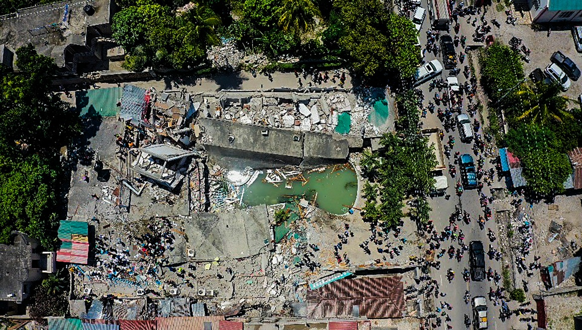 An aerial view of the Hotel Le Manguier, which was destroyed by the quake in Les Cayes. [Ralph Tedy Erol/AP Photo]