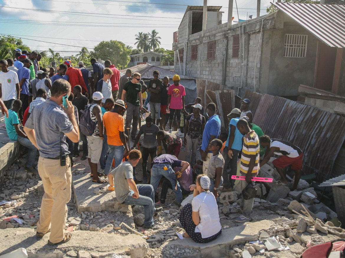 At least 860 homes were destroyed and more than 700 damaged. [Joseph Odelyn/AP Photo]