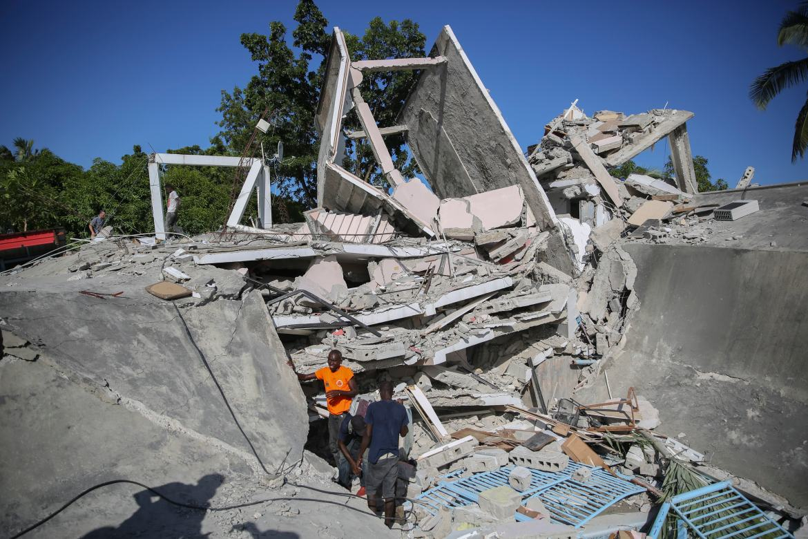 The Catholic bishop's residence lies in ruins after the earthquake in Les Cayes. [Joseph Odelyn/AP Photo]