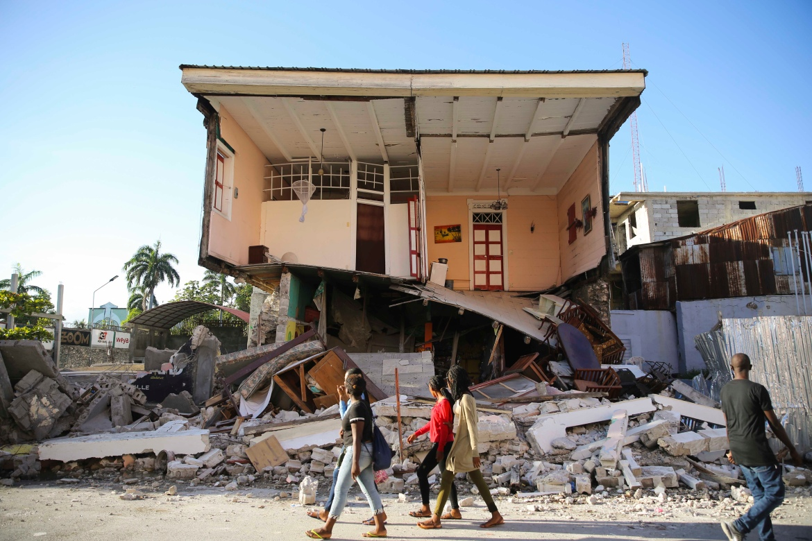 Access to the worst-hit areas was complicated by a deterioration in law and order that has left key access roads in parts of Haiti in the hands of gangs. [Joseph Odelyn/AP Photo]