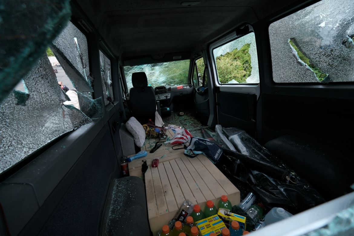 A van that was driven by anti-fascist protesters and smashed up by members of the far-right group Proud Boys is pictured near the scene of their rally. [Alex Milan Tracy/AP Photo]