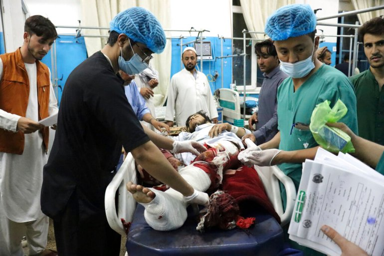 A victim receives medical assistance in a hospital after he was wounded in the deadly attacks outside the airport in Kabul, Afghanistan, Thursday, August 26, 2021 [Khwaja Tawfiq Sediqi/AFP]