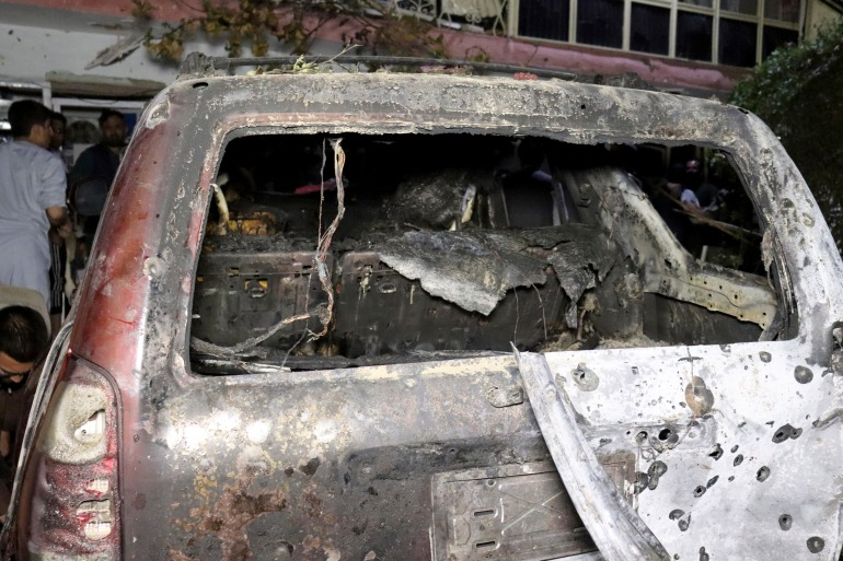 A destroyed vehicle is seen inside a house after a US drone attack in Kabul, Afghanistan, Sunday, August 29, 2021 [Khwaja Tawfiq Sediqi/ AP]